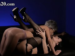 elegant brunette sucking penis of rubber
