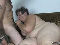 two busty lesbian lay on bed are rubbing