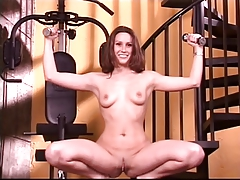 Brunette nympho with cute tits does sexy workout