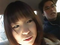 Busty asian having fun in a car